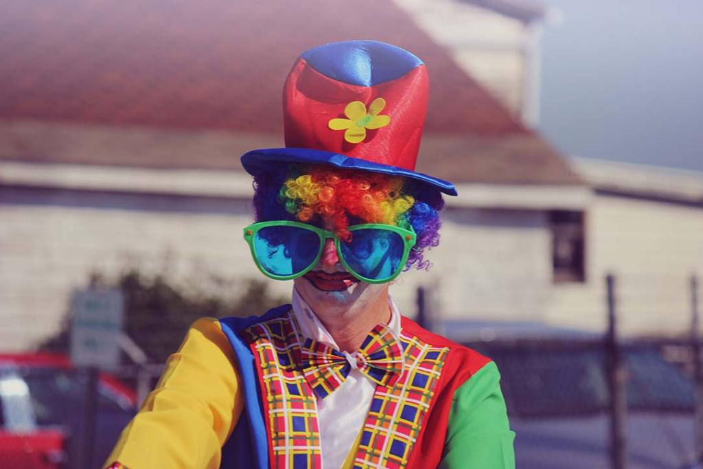 Colorful Clown photo by Levi Saunders (@levisaunders) on Unsplash