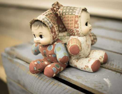 two old puppet-like dolls