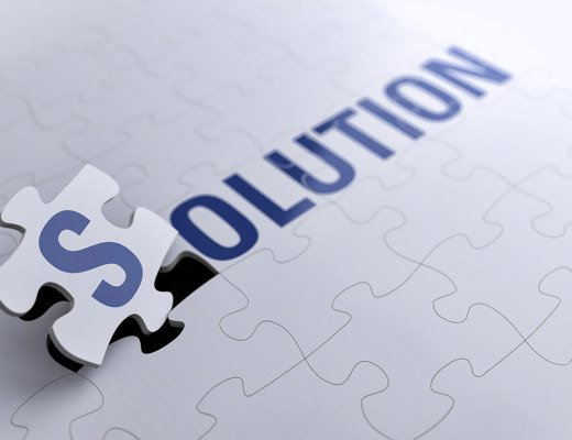 jigsaw puzzle with the word solution