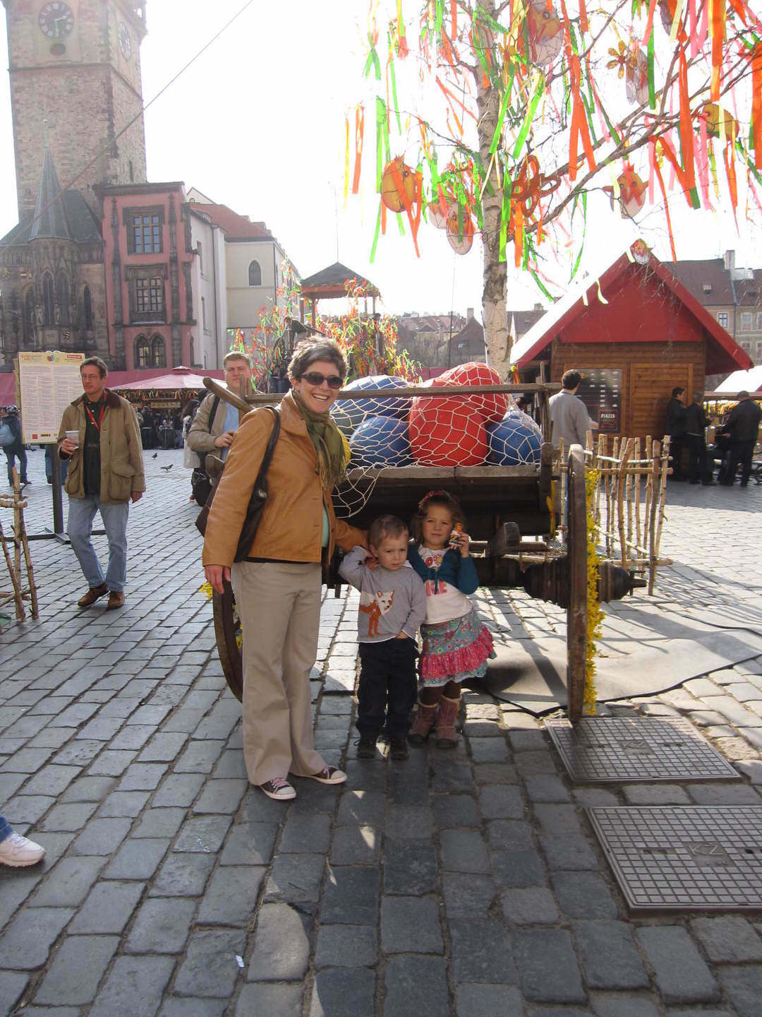 Emily, Anna & Oliver at Old Town Square in front of giant Easter eggs & pomlazky (whips)