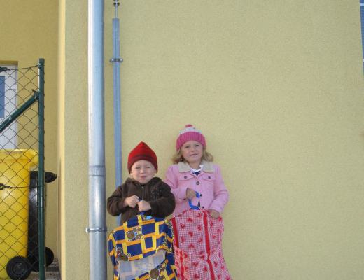 Oliver and Anna standing in front of Czech state preschool