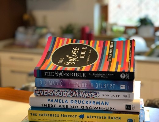 a colourful stack of books on bar