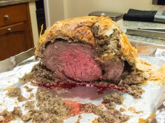 The finished product. While the middle was cooked pretty well, my meat therometer was placed incorrectly, so the roast as a whole ended up baking longer than necessary. Beef Wellington should be served quite pink throughout. Also, next time, I'd make sure we sharpened our knife before slicing to ensure a cleaner cut.