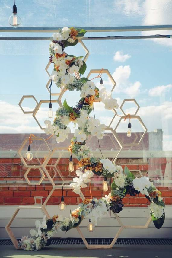 """Sick of overdone events? Stay classy with """"no theme"""" parties featuring pattern and color. Loving this hexagonal floral backdrop. Pattern Party Trends 