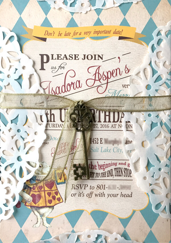 Our beautiful Alice inspired tea party invitation. I loved how it ended up with the doily and the key. Alice in Wonderland tea party sources | Halfpint Design