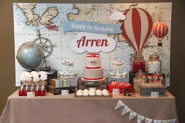 Vintage travel party themes are some of my favorite. This Up, Up, and Away theme is darling with the airplanes and hot air balloons. Small World gets big with cultural party themes | Halfpint Design
