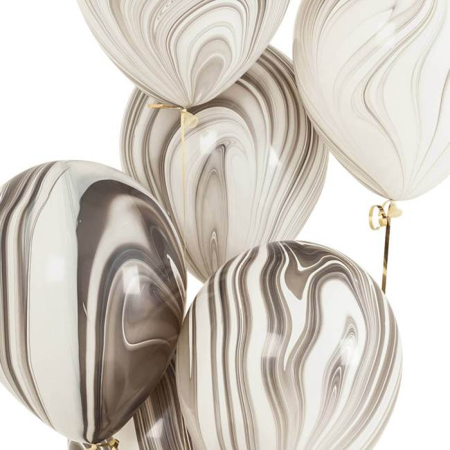 Marbling is such a beautiful sophisticated trend that can be dressed up or down. These marbled balloons add sophistication to any event. Pattern Party Trend | Halfpint Design - Trend Spotting, color trends, party trends