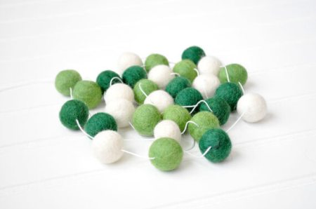 Green party supplies | Halfpint Design - This darling green felt ball garland makes for a great St. Patrick's Day party or a fun addition to a Dinosaur party, Princess and the Frog party, reptile party, etc.