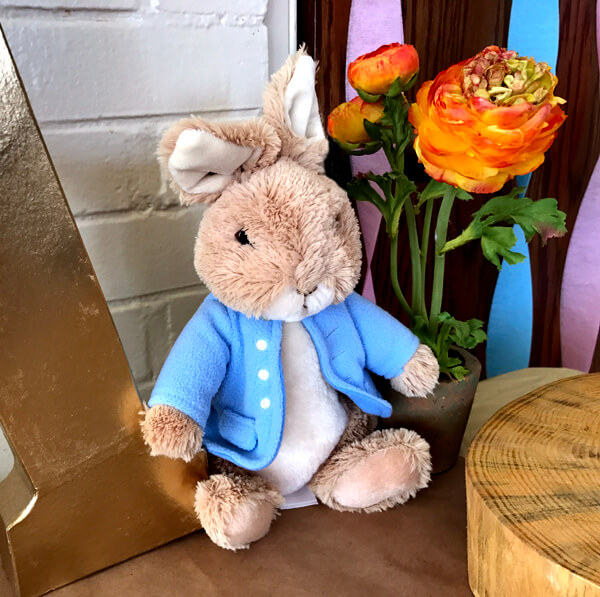 Peter Rabbit in Mr. McGregor's Garden First Birthday Party | Halfpint Design - Cute Peter Rabbit Plush toy on display