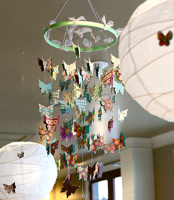 Butterfly First Birthday Party | Halfpint Design - Buffet butterfly chandelier centerpiece and butterfly lanterns