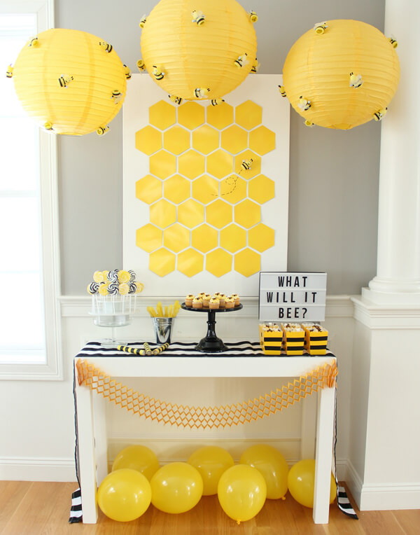 Classy Gender Reveal Party Ideas | Halfpint Design - What will it BEE? A visually pleasing contemporary take on the traditional theme. Love the honeycomb backdrop and beehive lanterns with little buzzing bees!