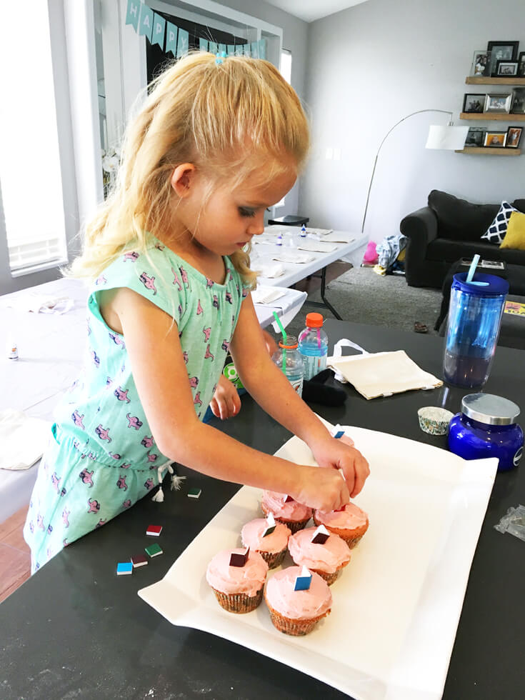 6th Birthday Book Party   Halfpint Design - A mini hostess decorated cupcakes made by Mom. Pink frosting and miniature books of course!