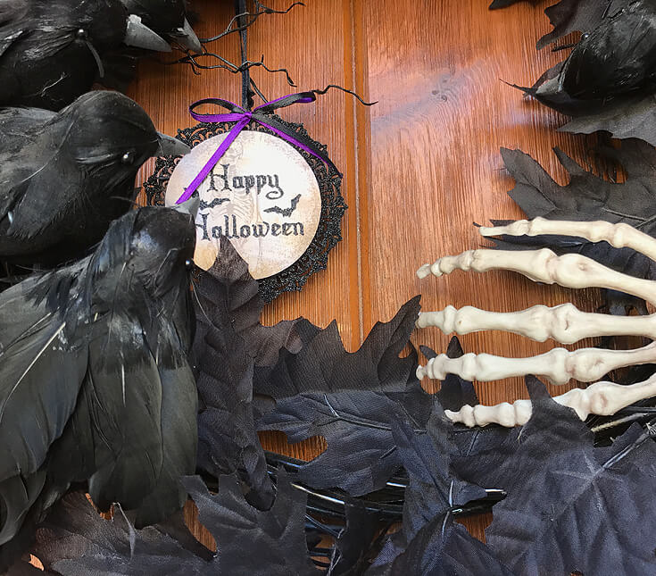 Holiday Decor Double Duty | Halfpint Design - This crow and skeleton wreath is perfect for a haunted mansion party, Harry Potter party, or a Day of the Dead Party. Black, purple, and green are perfect party colors to use before and after Halloween for a Hulk or Joker party. Double Duty Halloween decor.