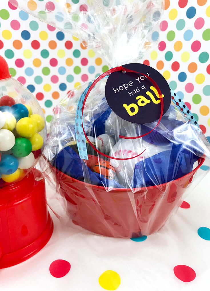 Ball Party Favor DIY | Halfpint Design - I wanted to keep the kids out of the chocolate and make sure we didn't have balls rolling everywhere so I wrapped up this favor in cellophane. It allowed the favors to add to the color scheme and overall decor.