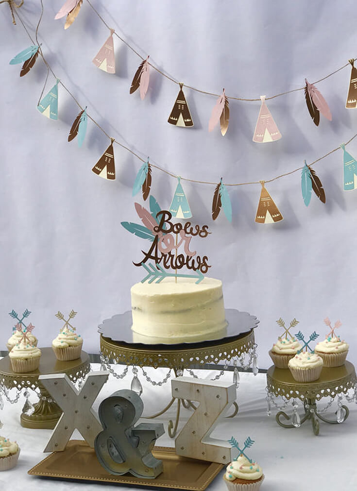 Bows or Arrows: Gender Reveal Party Ideas   Halfpint Design - This teepee and feather cut paper garland is darling! A great backdrop for a bows or arrows gender reveal, Boho baby shower or Wild One birthday party.