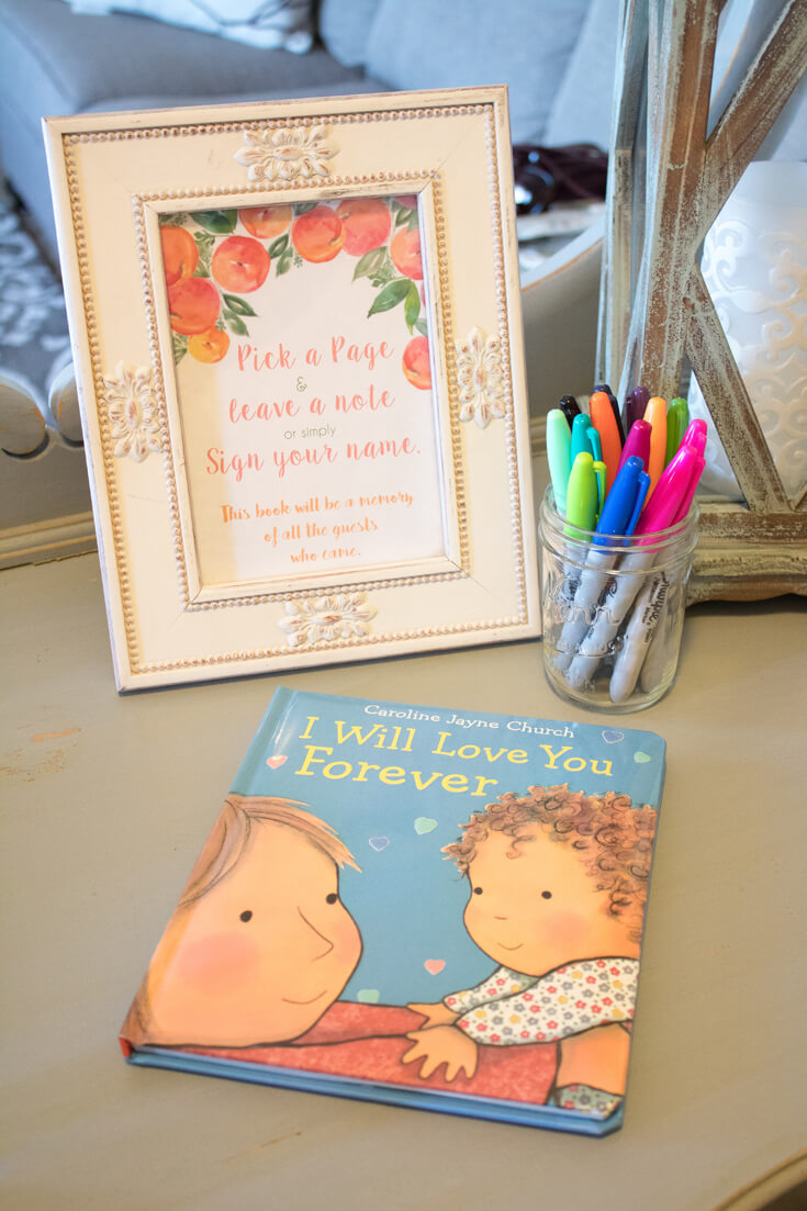 """I love when baby shower items can be used again. Having Mommy-to-be's childhood favorite """"I Will Love You Forever"""" as the sign in book ensures she and Georgia will see guests love notes over and over again. - Sweet Little Peach Baby Shower 