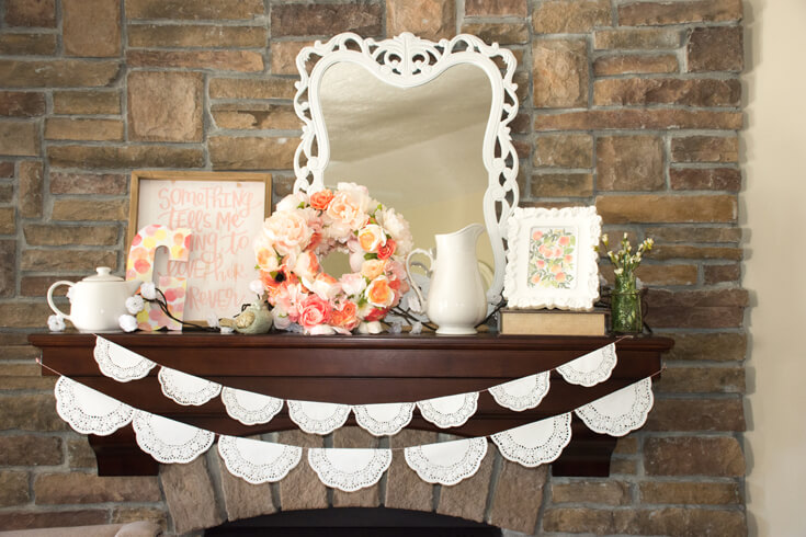 """Choose your focal points. This mantel is a prominent feature and styling it with additional nursery decor was a great idea. A """"G"""" for Georgia, another piece of sweet nursery art """"Something tells me I'm going to love her forever"""", and a lovely floral wreath made my mommy-to-be. The doilie garlands are so cute and very easy to make. - Sweet Little Peach Baby Shower 