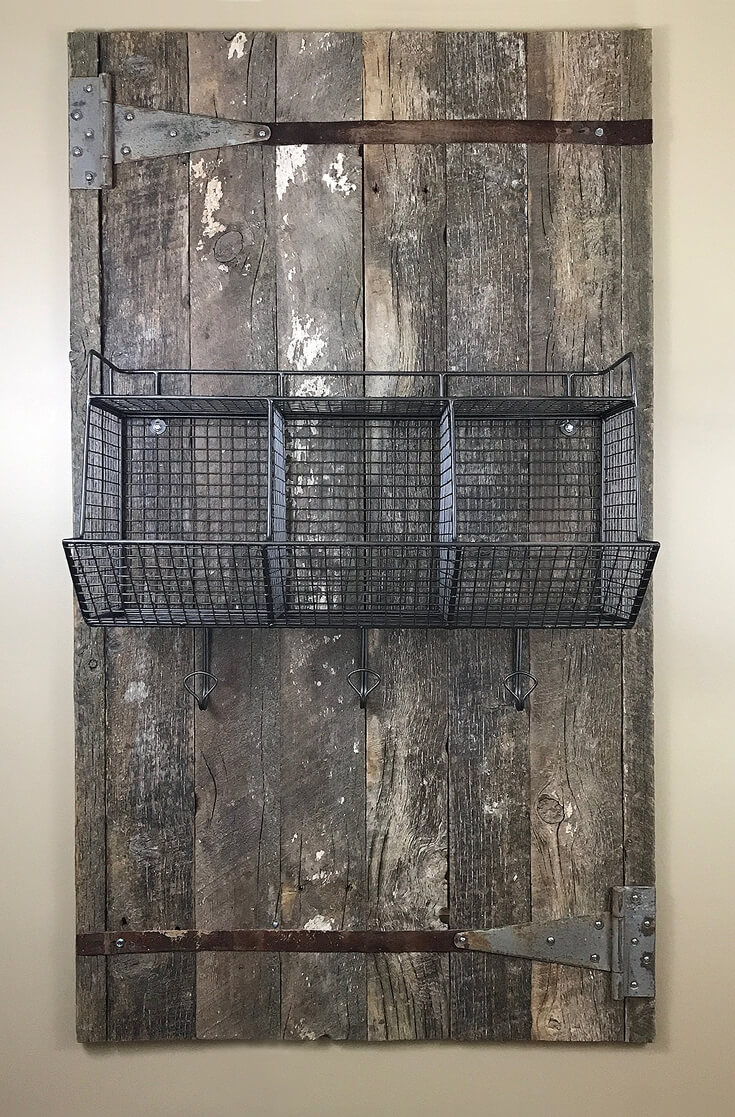 I designed this organizational wall with reclaimed barnwood, wire bins, and old belts! Farmhouse Back to School Organization | Halfpint Design