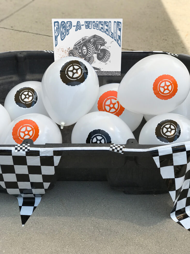 """I think this """"Pop a wheelie"""" might have been the favorite! It definitely was the first activity all the guests did. Sit on the tire balloon and pop the """"wheelie"""" - Monster truck party activity ideas-halfpintpartydesign.com-boy party theme"""