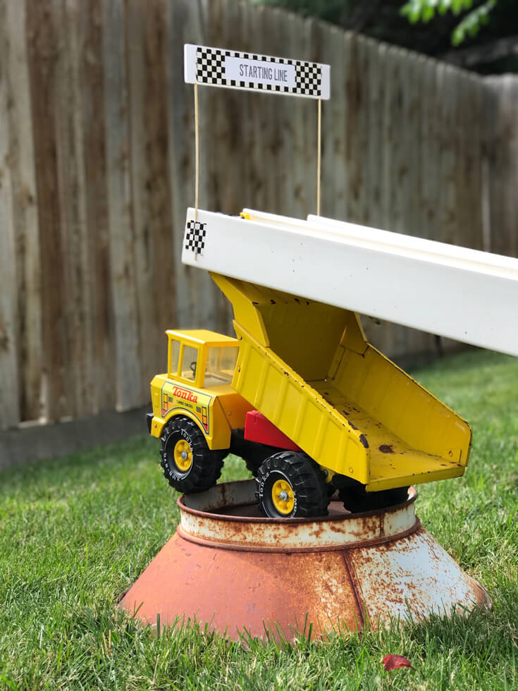 Awesome dump truck riser for race track. Monster truck party activity ideas | Halfpint Design - boy party theme