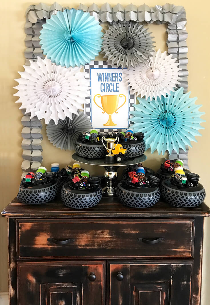 The Winner's Circle favor table was so much fun. Monster Truck Birthday Party Smash! Halfpint Design with Party Printables from HalfpintPartyDesign on Etsy. Boy party theme. 5th birthday.