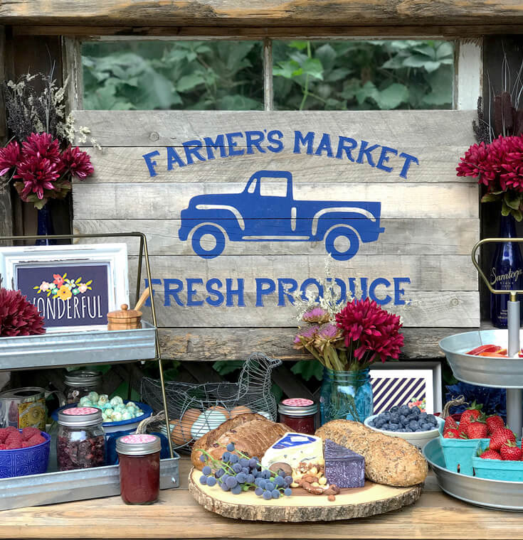 Wooden hutch filled with farmer's market produce for a Harvest Party Luncheon