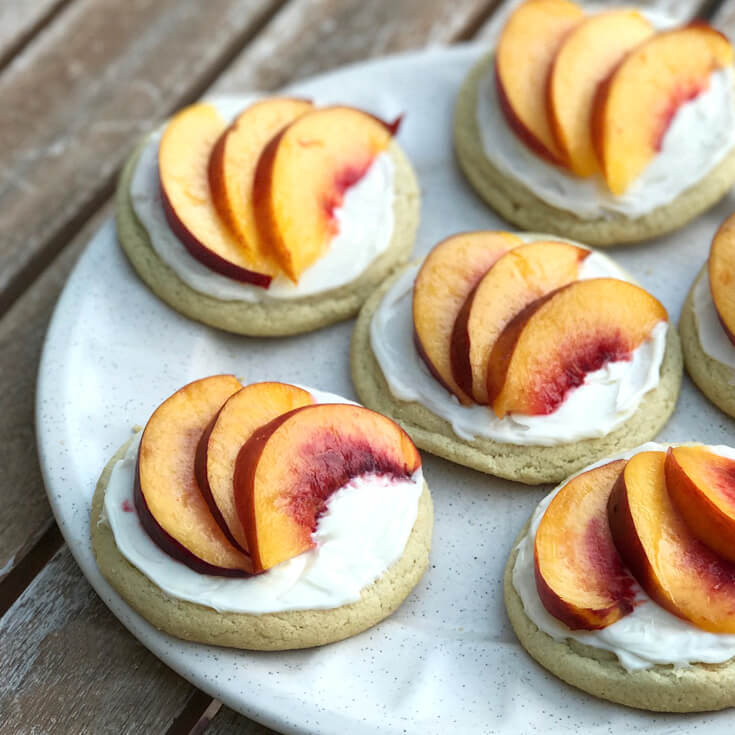 Step 3 - Cut peach or nectarine into thin slices and fan 3 pieces on top of frosting. Peach Sugar Cookie Tart Recipe | Halfpint Design - easy recipe, cookies recipe, event food, fruit dessert