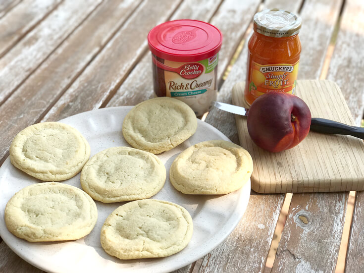 "Only 4 ingredients you need to gather unless you're one of those people that likes to ""plan ahead"" and wants to make your cookies and frosting from scratch! Peach Sugar Cookie Tart Recipe 