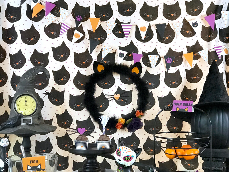 """Black cat fabric background looks busy but was awesome! So many fun cat and witch accessories make this party perfect for Halloween. """"Black Cat Halloween Party Reveal"""" on Halfpint Design - Halloween party ideas, kitty cat party, kids party, cat party treats"""