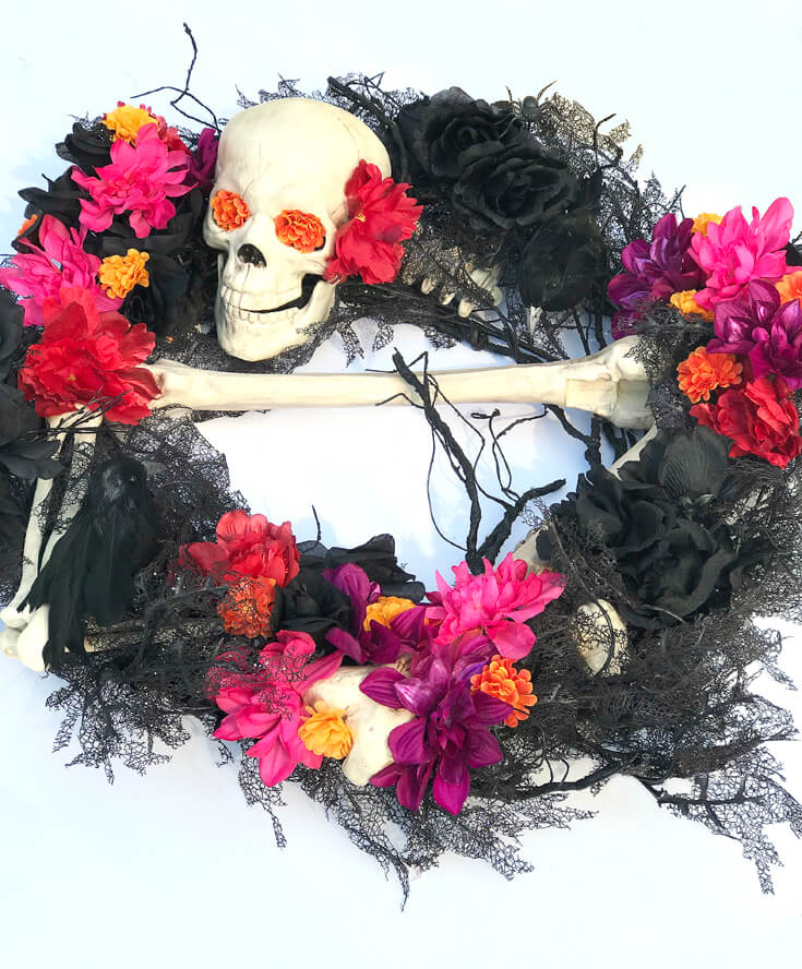 I transformed my Halloween wreath for my Day of the Dead party. Dia de los Muertos Party Resources | Halfpint Design - Halloween party, party decorations, party clothes