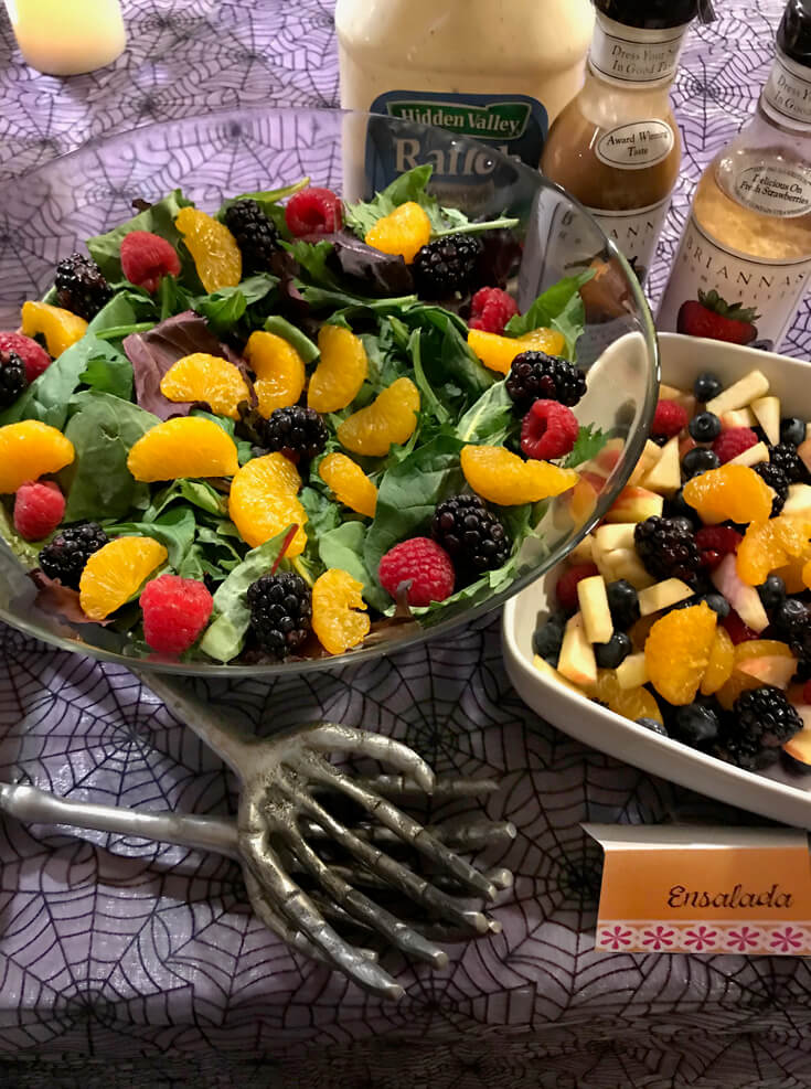 Any food can be dressed up for a Coco Movie Party. Add bright fruits in a fun pattern and this salad is suddenly very Day of the Dead! Coco Viewing Party Tips at Halfpint Design. Day of the Dead Party, Dia de los Muertos, Coco birthday party