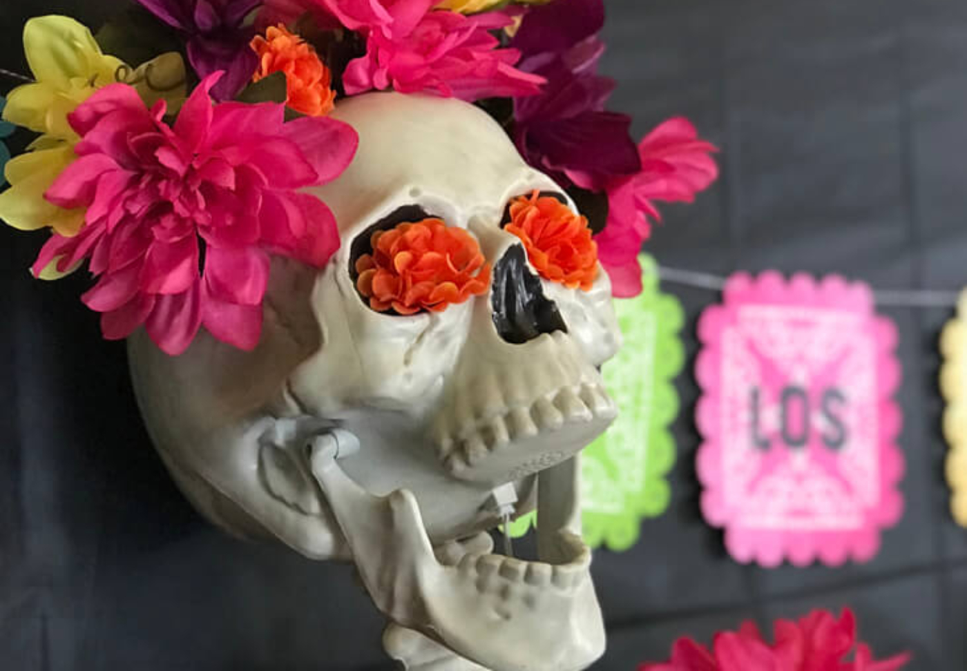 Skeletons get a face list for the Day of the Dead! Add flowers to your Halloween decor for bright and cheery sugarskulls. Coco Viewing Party Tips at Halfpint Design. Day of the Dead Party, Dia de los Muertos, Coco birthday party
