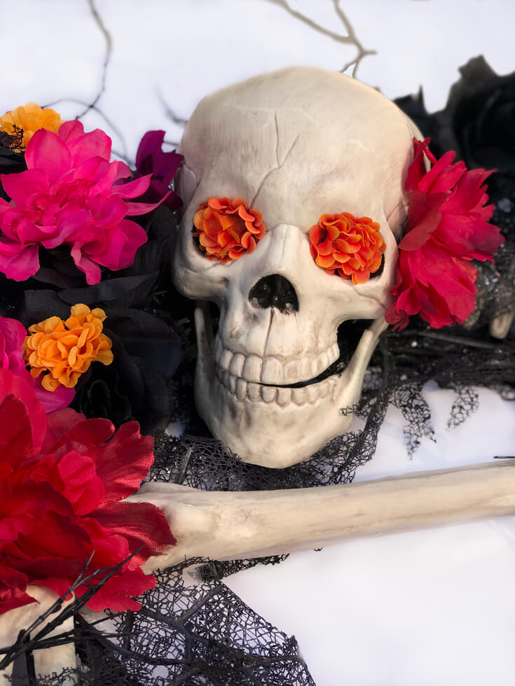 Hello lovely! A few flowers in the skull makes for a less scary and more inviting sugar skull for a Coco viewing party. Day of the Dead Holiday Wreath Transformation from Halfpint Design. Day of the Dead party, Dia de los Muertos decor, Decor DIY