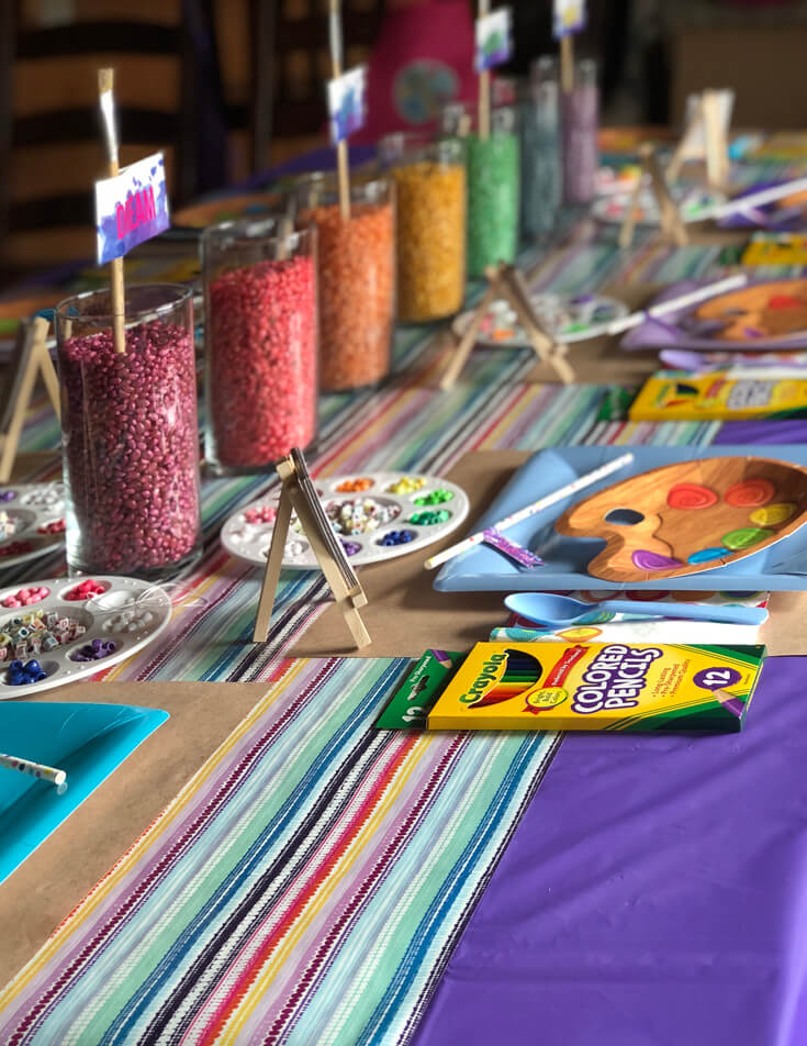 Rainbow centerpieces and mini easels for an Art themed birthday party where you can party like Picasso! Halfpint Design. Art party, painting party, rainbow party.