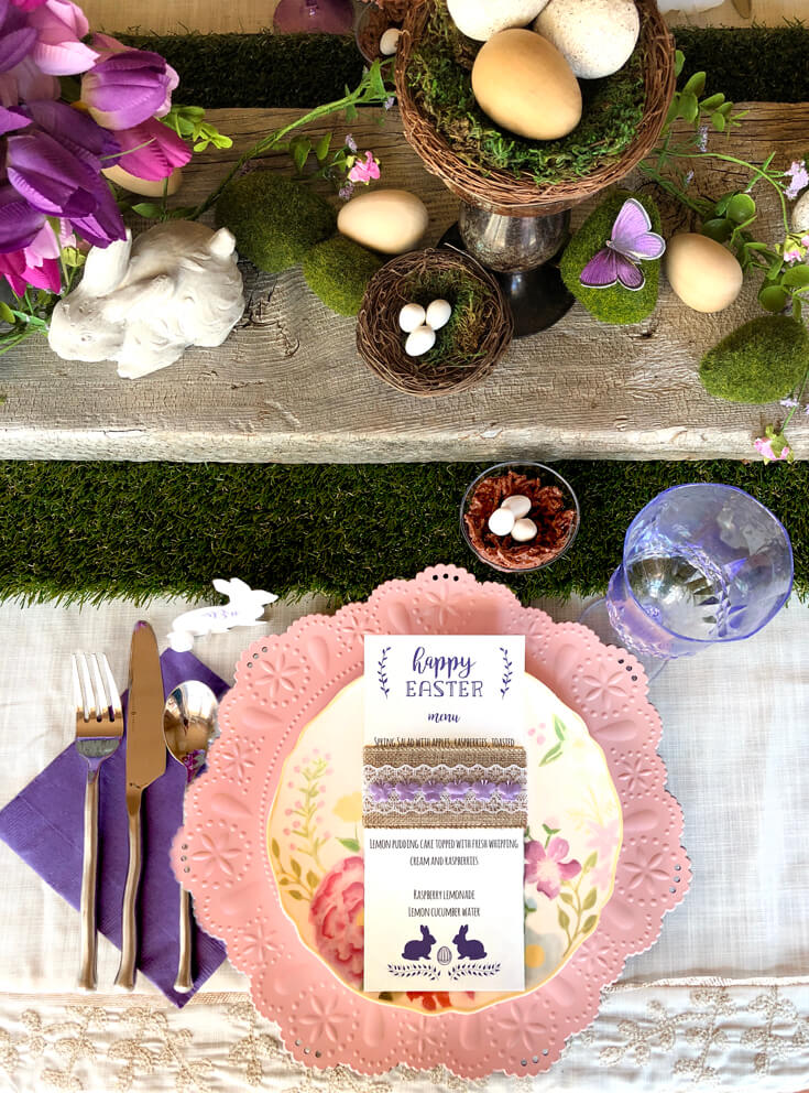 Easter place setting. Pink charger, floral plate, free printable menu, purple napkin, and small edible bird nest.