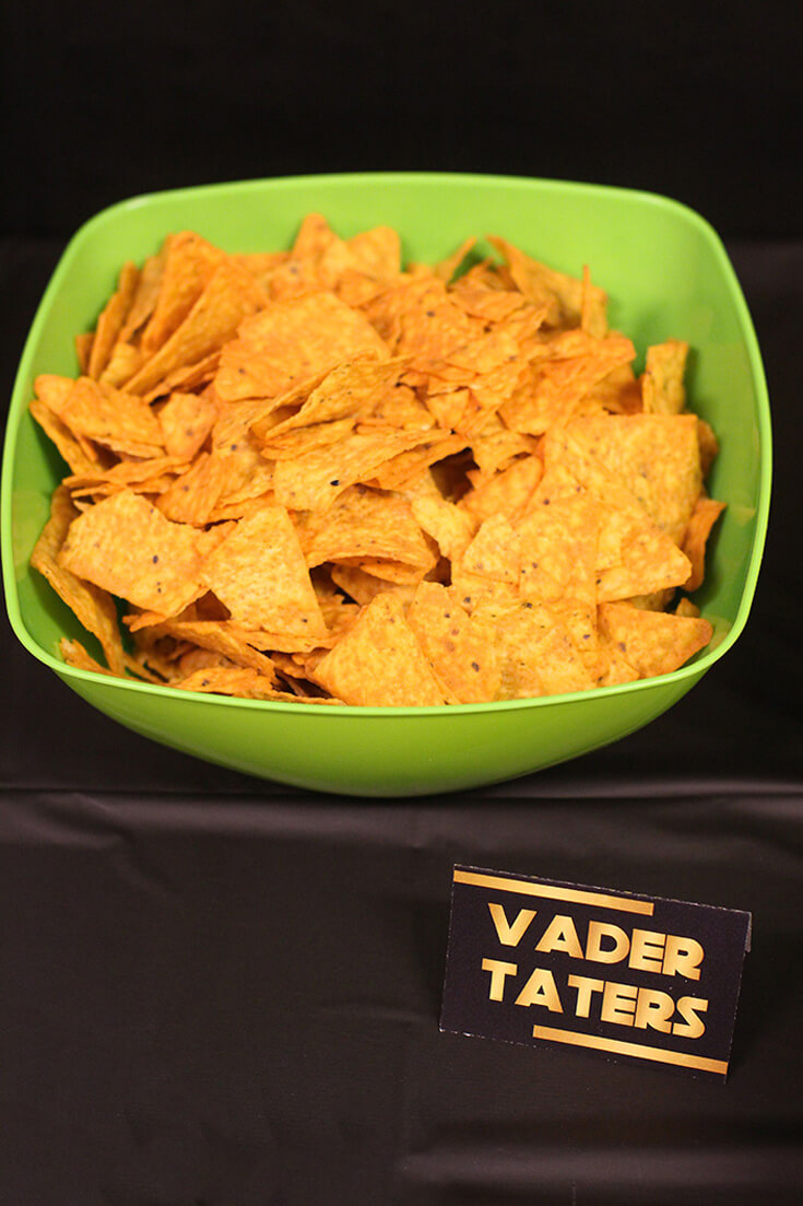 "Bowl of chips with a label ""Vader Taters"" for a Star Wars Birthday Party"