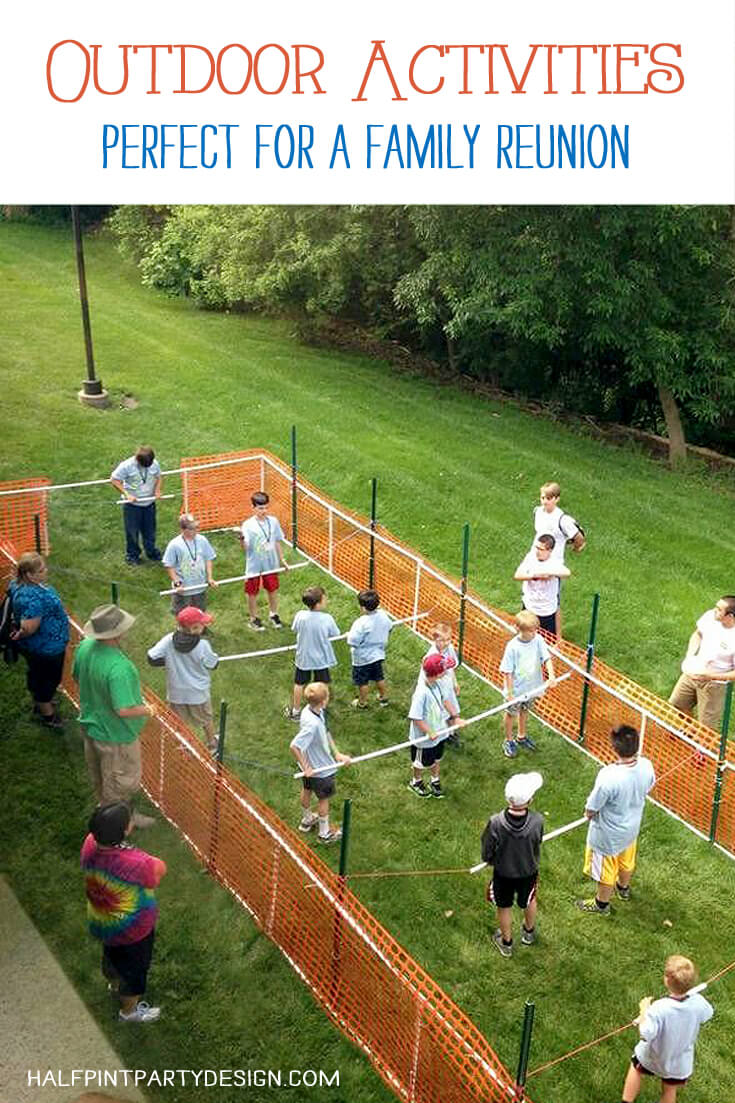 A human foosball court set up in a grass field for the ultimate outdoor party game!
