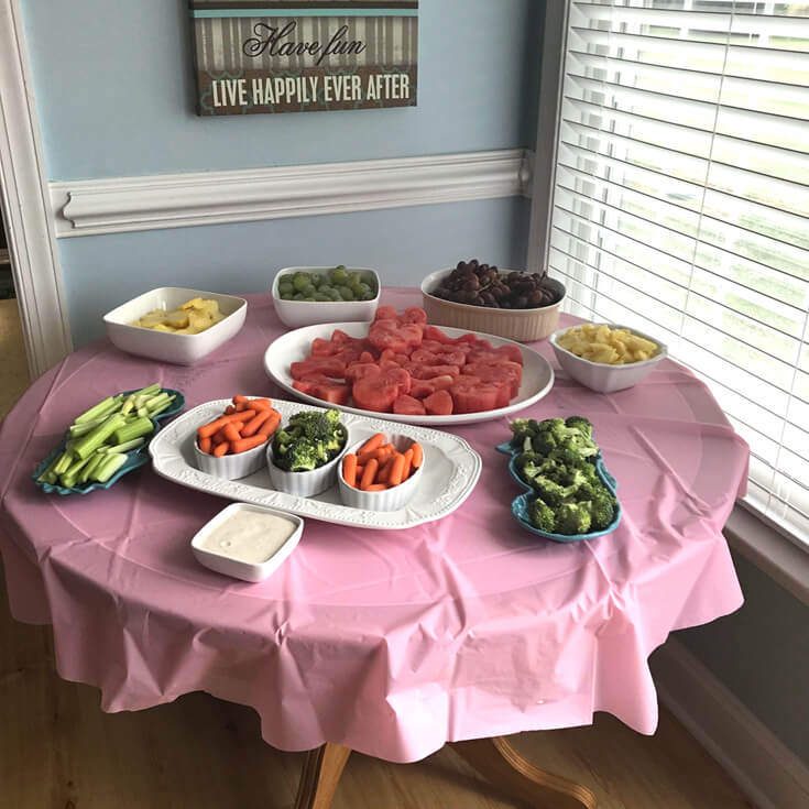 Food table for Minnie Mouse first birthday party
