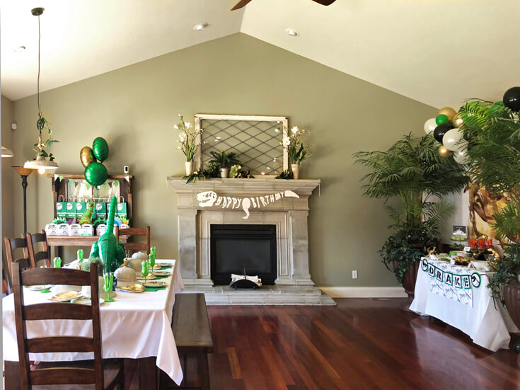 Living room decorated for a fun dinosaur birthday party