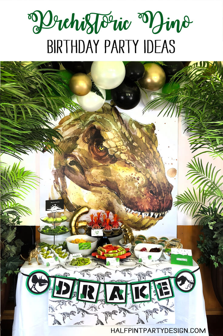 Prehistoric Dinosaur birthday party ideas with large T-Rex backdrop and food table