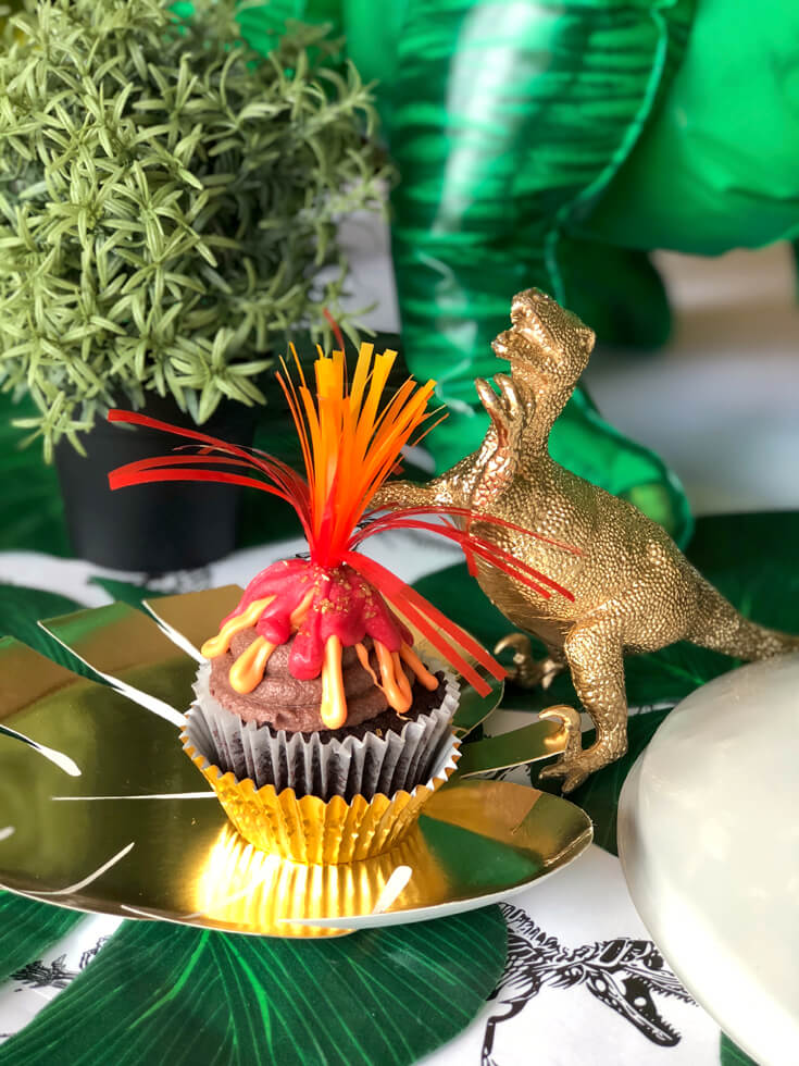 Volcano cupcake with golden dino is a great dinosaur birthday party idea!