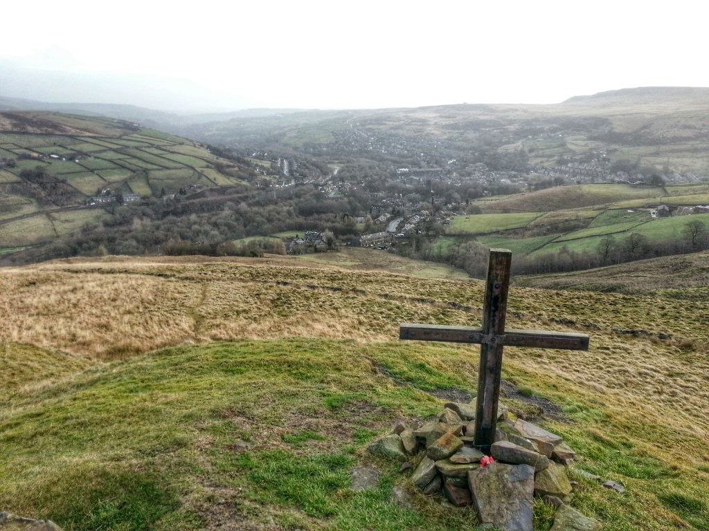 Pule Hill WW2 Memorial Cross - looking back down to Marsden on the Poetry Trail Marsden