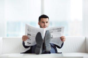 man reading newspaper photo