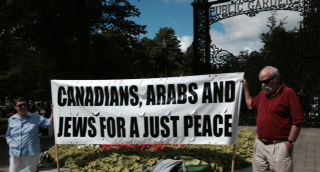 This sign attracted many people who signed the letters to PM Harper