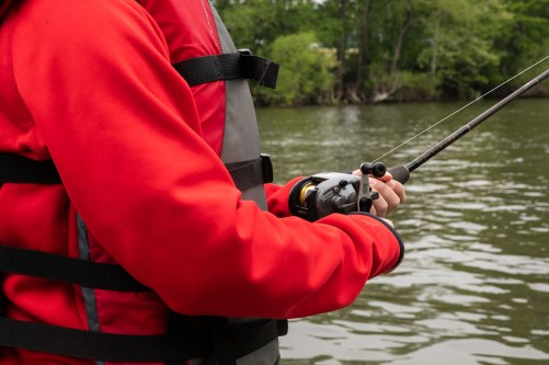Person in life preserver with fishing rod on the Roanoke River