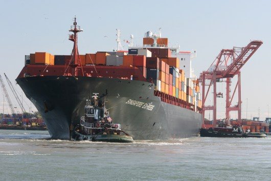 photo of loaded cargo ship at port