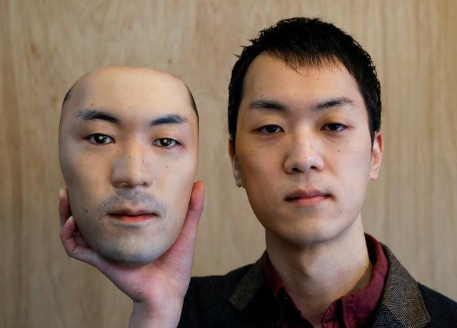 Shuhei Okawara, 30, owner of mask shop Kamenya Omote, holds a super-realistic face mask based on his real face, made by using 3D printing technology, in Tokyo, Japan December 16, 2020. REUTERS