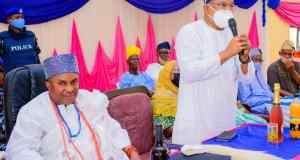 Bola Oyebamiji speaking, while Oba Kayode Adenekan Afolabi looks on