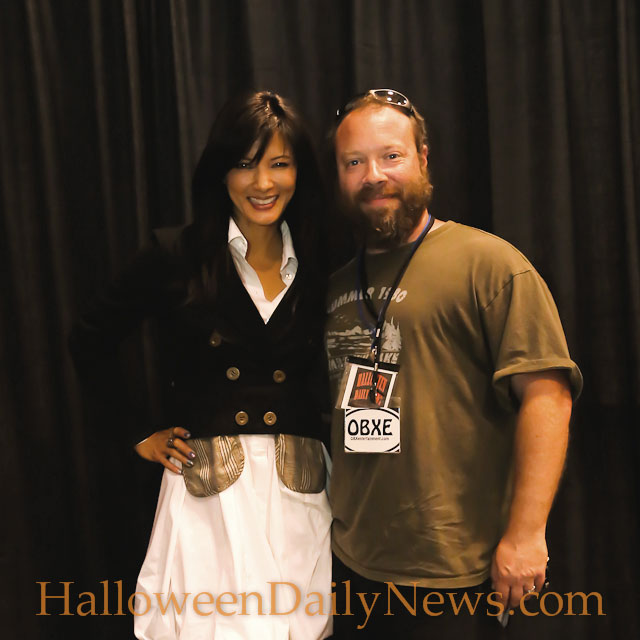 Kelly Hu with HalloweenDailyNews.com editor in chief Matt Artz at Tidewater Comicon, May 16, 2015.