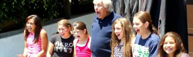 Dick Van Dyke poses with neighborhood kids and his new Halloween decoration from Distortions Unlimited.